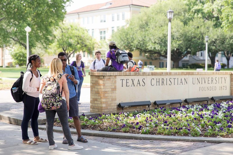 Image of students around the TCU sign